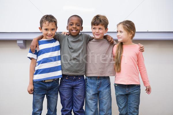 Одноклассники улыбаясь камеры классе девушки Сток-фото © wavebreak_media