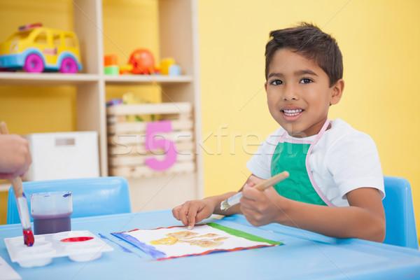 Cute wenig Junge Malerei Tabelle Klassenzimmer Stock foto © wavebreak_media