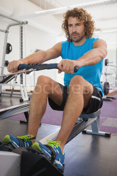 Hombre guapo resistencia banda gimnasio guapo Foto stock © wavebreak_media