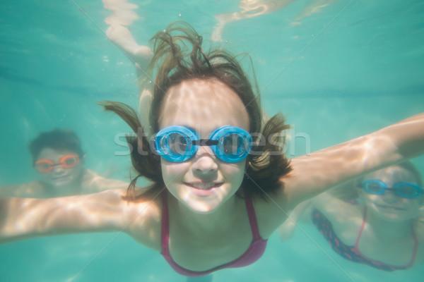 Cute dzieci stwarzające podwodne basen wypoczynku Zdjęcia stock © wavebreak_media