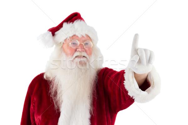 Santa Claus points at something Stock photo © wavebreak_media