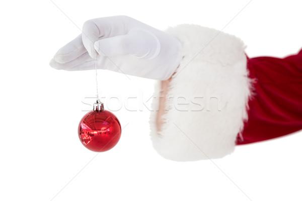 Mikulás tart piros csecsebecse fehér kéz Stock fotó © wavebreak_media
