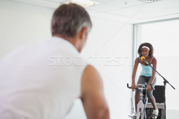 Spinning instructor motivating her class Stock photo © wavebreak_media
