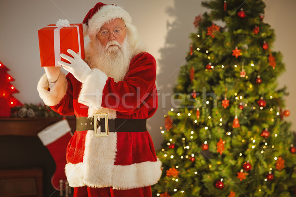 Father christmas delivering gift at christmas eve Stock photo © wavebreak_media