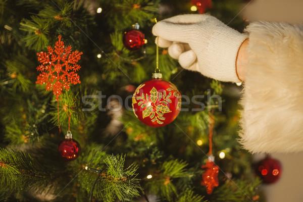 Kéz mikulás akasztás csecsebecse karácsonyfa otthon Stock fotó © wavebreak_media
