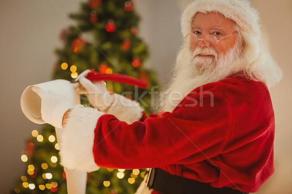 Smiling santa claus writing list  Stock photo © wavebreak_media