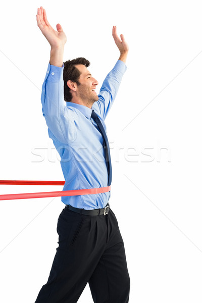 Happy businessman crossing finishing line Stock photo © wavebreak_media