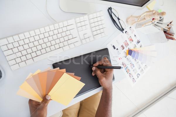 Designer using digitizer and colour wheel Stock photo © wavebreak_media