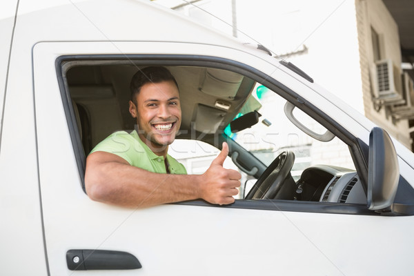 Smiling man showing thumbs up driving his van Stock photo © wavebreak_media