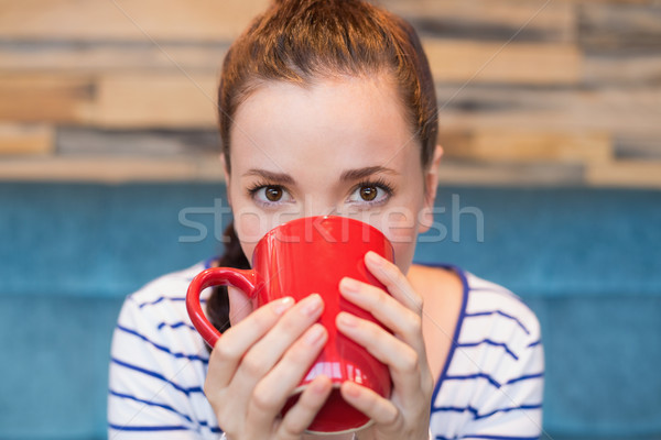Young woman having mug of coffee Stock photo © wavebreak_media