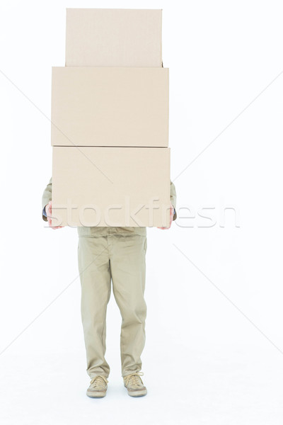Delivery man carrying stacked boxes Stock photo © wavebreak_media