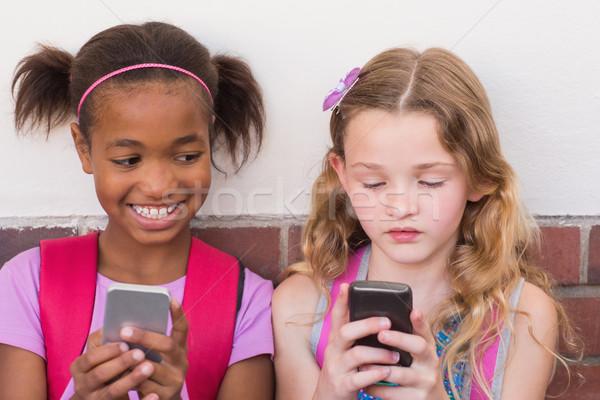 Cute мобильного телефона девушки телефон Сток-фото © wavebreak_media