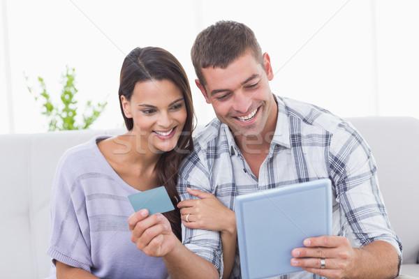 Couple shopping online on digital tablet using credit card Stock photo © wavebreak_media