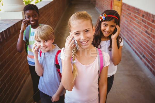 Szkoły dzieci korytarz portret uśmiechnięty mały Zdjęcia stock © wavebreak_media