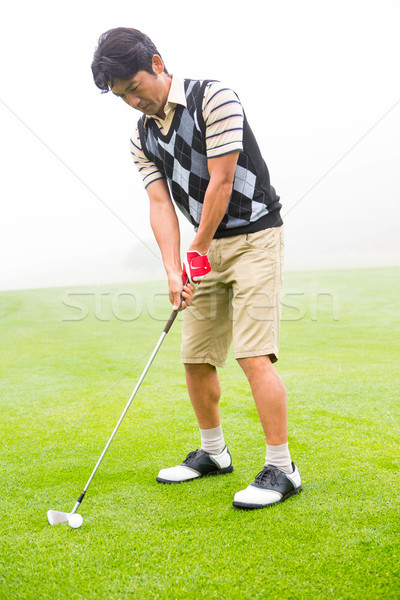 Concentrating golfer lining up his shot Stock photo © wavebreak_media