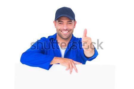 Mechanic with blank placard gesturing thumbs up Stock photo © wavebreak_media