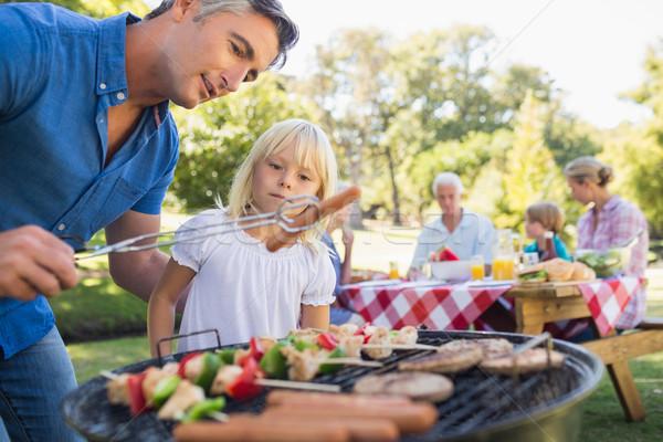 Boldog apa barbecue lánygyermek napos idő tavasz Stock fotó © wavebreak_media