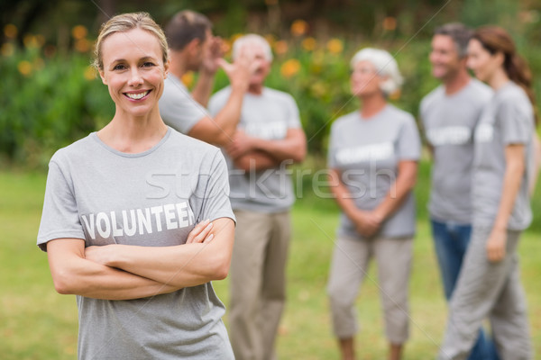 Happy volunteer looking at camera with arms crossed Stock photo © wavebreak_media