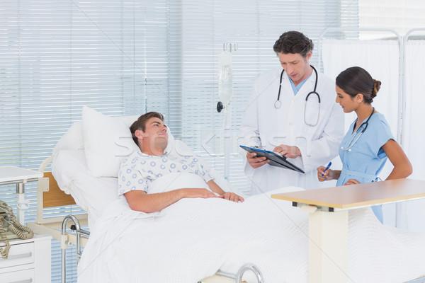 Doctors taking care of patient Stock photo © wavebreak_media