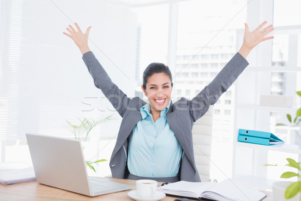 Happy businesswoman with raised arms Stock photo © wavebreak_media