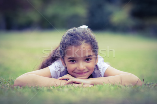 Smiling little girl looking at the camera Stock photo © wavebreak_media