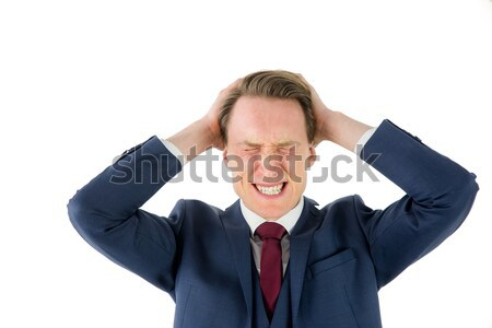 Nervous businessman looking at camera with hand on head  Stock photo © wavebreak_media