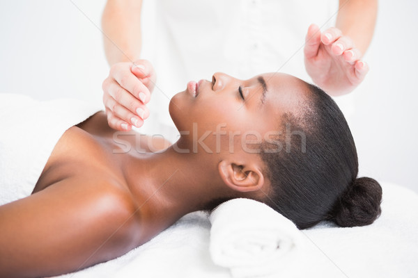 Pretty woman enjoying a reiki technique Stock photo © wavebreak_media
