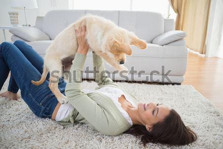 Happy little girl with her puppy Stock photo © wavebreak_media