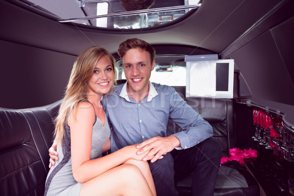Happy couple smiling in limousine Stock photo © wavebreak_media