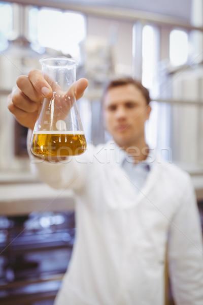 Thoughtful scientist holding a beaker Stock photo © wavebreak_media