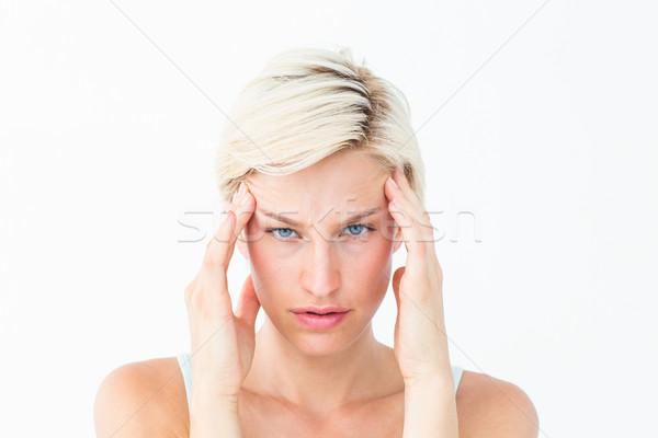 Belle souffrance maux de tête regarder caméra Photo stock © wavebreak_media