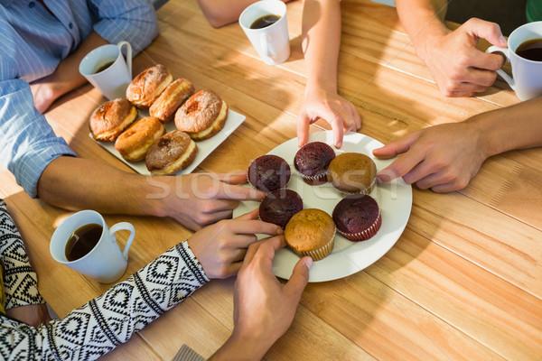 Business people taking cakes on table Stock photo © wavebreak_media
