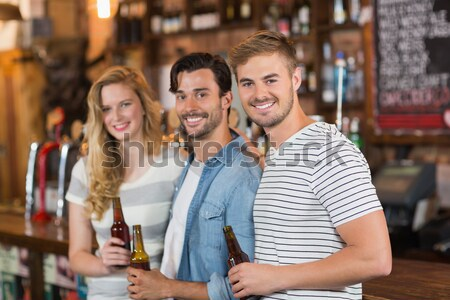 Smiling hipster couple in front of barista Stock photo © wavebreak_media