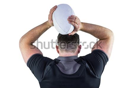 Stock photo: Rugby player about to throw a rugby ball