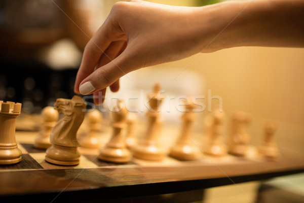 Cropped hand of businesswoman playing chess Stock photo © wavebreak_media