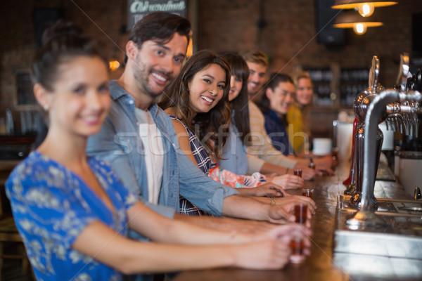 Mosolyog barátok tart rövid szemüveg pult Stock fotó © wavebreak_media