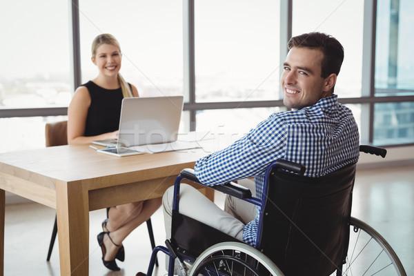 Portrait of smiling executives at desk Stock photo © wavebreak_media