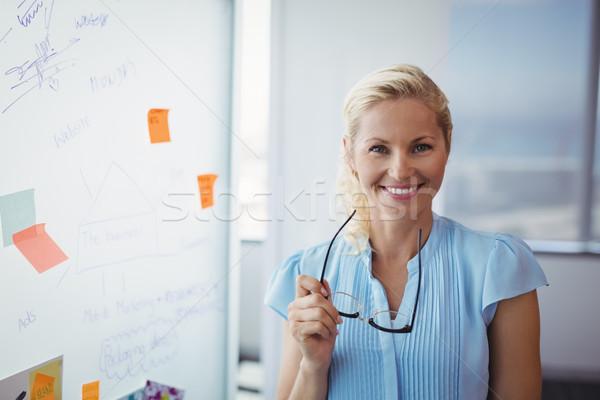 Retrato sonriendo ejecutivo gafas oficina Foto stock © wavebreak_media