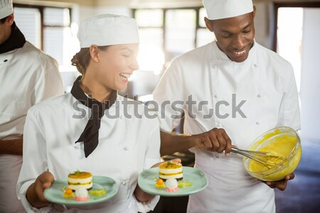 Chefs chopping vegetables in the commercial kitchen Stock photo © wavebreak_media