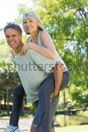 Portrait of smiling man and woman standing with bicycle  Stock photo © wavebreak_media