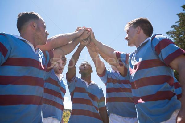 Alulról fotózva kilátás rögbi csapat karok a magasban áll Stock fotó © wavebreak_media