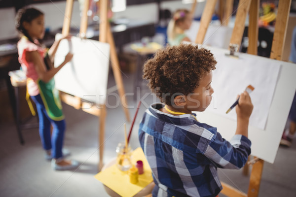 Attentive schoolboy panting on canvas Stock photo © wavebreak_media