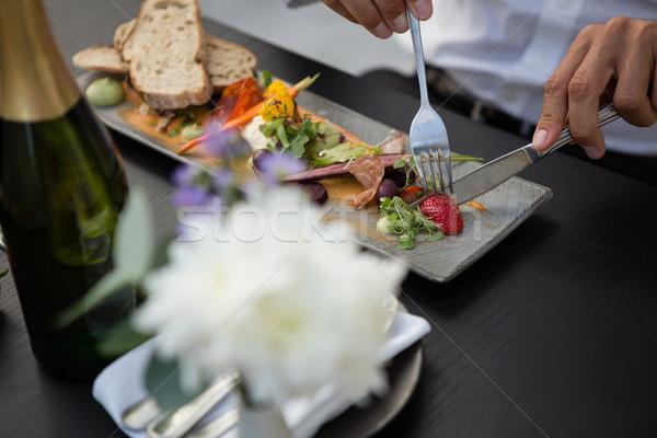 Mid section of man having lunch in restaurant Stock photo © wavebreak_media