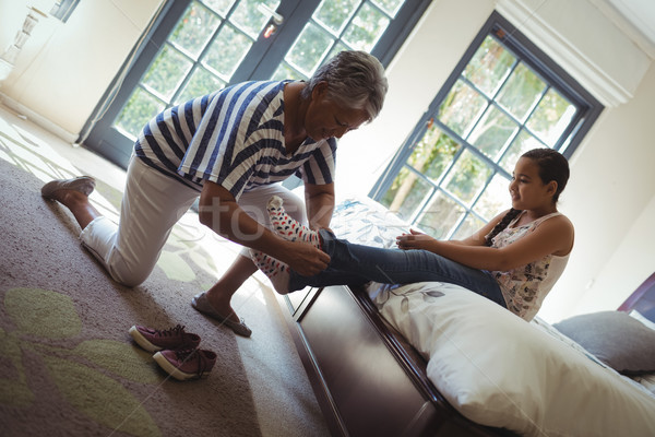 бабушки помогают внучка носить носки кровать Сток-фото © wavebreak_media