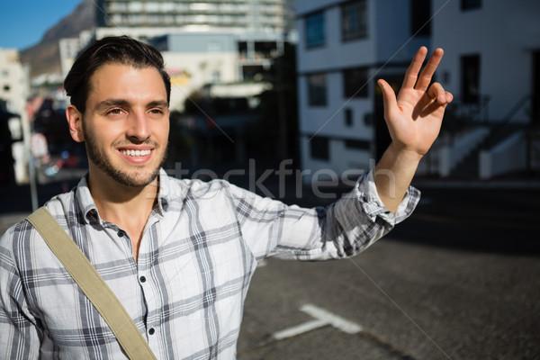 Sorridente homem em pé rua Foto stock © wavebreak_media