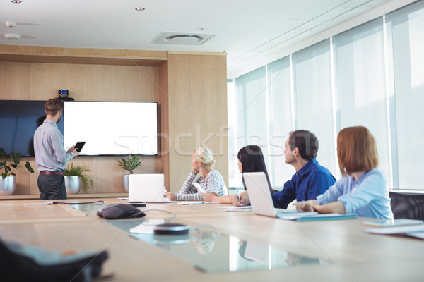 Business people at conference table in office Stock photo © wavebreak_media