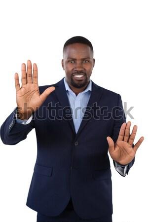 Mosolyog üzletember megérint láthatatlan képernyő fehér Stock fotó © wavebreak_media