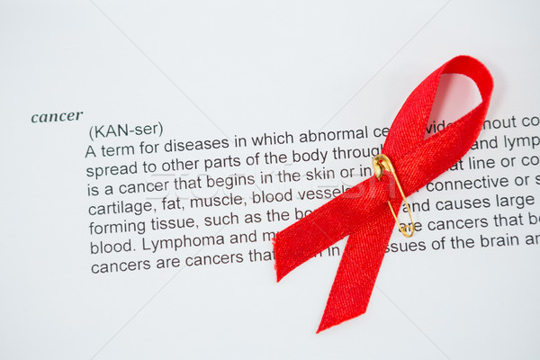 High angle view of red AIDS Awareness ribbon on cancer text Stock photo © wavebreak_media