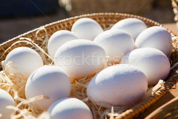 Close-up of eggs in wicker basket Stock photo © wavebreak_media