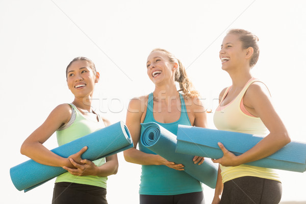 Laughing sporty women with exercise mats  Stock photo © wavebreak_media